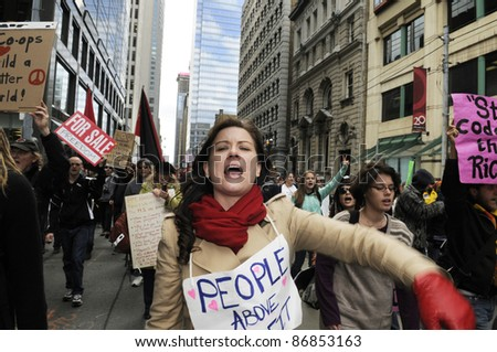 TORONTO - OCTOBER 17:  Protestors participating during the Occupy Toronto Movement on October 17, 2011 in Toronto, Canada. - stock photo
