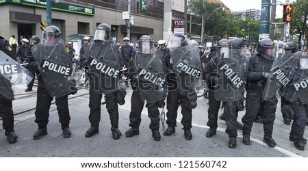 TORONTO, ON/CANADA - JUNE 27, 2010:  Police stand guard at the G20 Protest  on June 27, 2010 in Toronto - stock photo