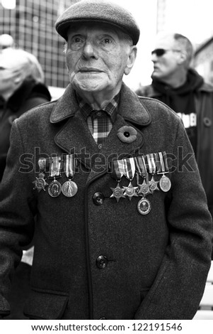 TORONTO, ON/CANADA - NOVEMBER 11, 2011: Vetreran Soldier from World War Two watches events during remembrance day events on November 11, 2011 in Toronto - stock photo