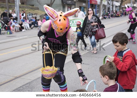 Easter parade stock images royalty free images vectors toronto ontariocanada apr 16 2017 woman in easter costume distributes negle Choice Image