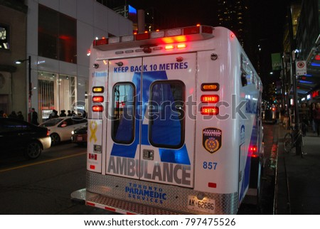 TORONTO, ONTARIO, CANADA - October 27 2017 - Ambulance At Dundas Square on Yonge Street, city, 911, Emergency, crash, Accident on the road, injuries, paramedics with stretcher, flashing lights, aid