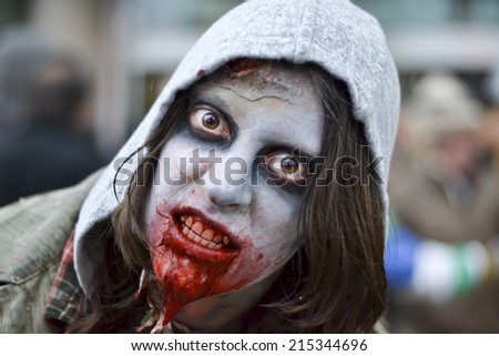 TORONTO, ONTARIO/CANADA - 26th SATURDAY  OCTOBER 2013 : Girl  dress up as zombie showing anger expression  on 11th annual Zombie in Toronto,Canada.  - stock photo