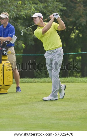 TORONTO, ONTARIO - JULY 21: English golfer Paul Casey follows his tee shot during a pro-am event at the RBC Canadian Open golf on July 21, 2010. - stock photo
