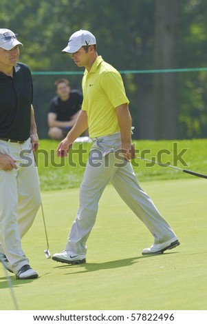 TORONTO, ONTARIO - JULY 21:English golfer Paul Casey follows his tee shot during a pro-am event at the RBC Canadian Open golf on July 21, 2010. - stock photo