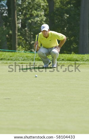 TORONTO, ONTARIO - JULY 21 : English golfer Paul Casey  lines up a putt during a pro-am event at the RBC Canadian Open golf on July 21, 2010 in Toronto, Ontario - stock photo