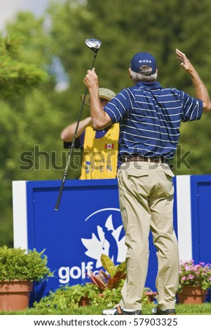 TORONTO, ONTARIO - JULY 21, 2010 : Golfer Fred Couples reacts to balls landiing near him during a pro-am at the RBC Canadian Open,St. George's; Golf and Country Club, Toronto, Ontario, July 21, 2010 - stock photo