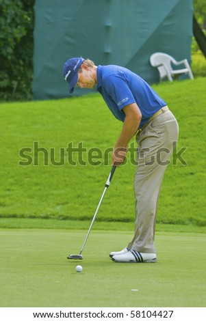 TORONTO, ONTARIO - JULY 21 : South African golfer Retief Goosen putts in during a pro-am event at the RBC Canadian Open golf on  July 21, 2010 in Toronto, Ontario - stock photo
