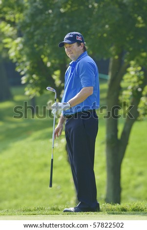 TORONTO, ONTARIO - JULY 21: South African golfer Tim Clark chips onto a green during a pro-am event at the RBC Canadian Open golf on July 21, 2010. - stock photo