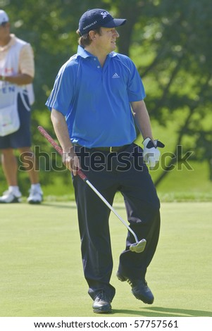 TORONTO, ONTARIO - JULY 21: South African golfer Tim Clark walks on a green during a pro-am event at the RBC Canadian Open golf on July 21, 2010. - stock photo