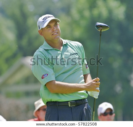 TORONTO, ONTARIO - JULY 21: U.S. golfer Bill Haas follows his tee shot during a pro-am event at the RBC Canadian Open golf on July 21, 2010. - stock photo