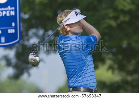 TORONTO, ONTARIO - JULY 21: U.S. golfer Brandt Snedeker follows his tee shot during a pro-am event at the RBC Canadian Open golf on July 21, 2010 in Toronto, Ontario. - stock photo