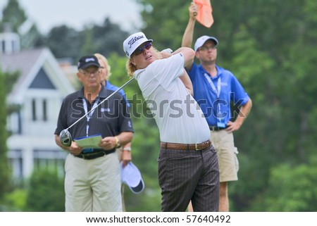 TORONTO, ONTARIO - JULY 21: U.S. golfer Charley Hoffman follows his tee shot during a pro-am event at the RBC Canadian Open golf on July 21, 2010 in Toronto, Ontario. - stock photo