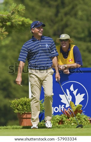 TORONTO, ONTARIO - JULY 21, 2010 : U.S. golfer Fred Couples talks to his caddy during a pro-am event at the RBC Canadian Open,St. George's; Golf and Country Club, Toronto, Ontario, July 21, 2010 - stock photo