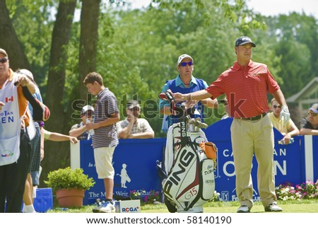 TORONTO, ONTARIO - JULY 21: US golfer Chris DiMarco selects a club during a pro-am event at the RBC Canadian Open golf, St. George's; Golf and Country Club on July 21, 2010 in Toronto, Ontario. - stock photo