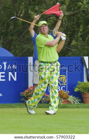 TORONTO, ONTARIO - JULY 21: US golfer John Daly follows his tee shot during a pro-am event at the RBC Canadian Open golf, St. George's; Golf and Country Club; Toronto, Ontario, July 21, 2010 - stock photo