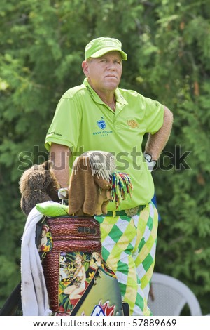 TORONTO, ONTARIO - JULY 21: US golfer John Daly waiting for his turn during a pro-am event at the RBC Canadian Open golf  St. George's; Golf and Country Club; July 21, 2010 in Toronto, Ontario. - stock photo