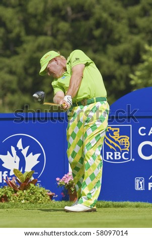 """TORONTO, ONTARIO - JULY 21: US golfer John  """"grip it and rip it"""" Daly during a pro-am event at the RBC Canadian Open golf, St. George's, Golf and Country Club July 21, 2010 Toronto, Ontario. - stock photo"""