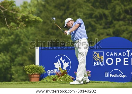 TORONTO, ONTARIO - JULY 21: US golfer Webb Simpson hits a tee shot during a pro-am event at the RBC Canadian Open golf, St. George's; Golf and Country Club on July 21, 2010 in Toronto, Ontario. - stock photo