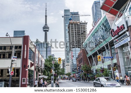 TORONTO, ONTARIO - SEPTEMBER 5: Street view of downtown Toronto, in Toronto, ON, on September 5, 2013. Toronto is the 5th largest city in North America, behind NYC, LA, Chicago, and Mexico City. - stock photo
