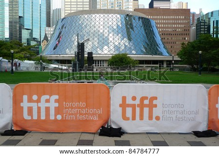 TORONTO - SEPTEMBER 16: Banners of the 36th Toronto International Film Festival in front of Roy Thomson Hall, a major venue of the event, Sept 16, 2011 in Toronto, Canada - stock photo
