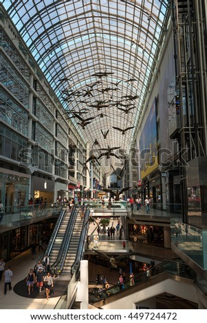 TORONTO - SEPTEMBER 5: Inside view of a modern shopping mall (Eaton Centre) in Toronto city centre, full of shoppers and visitors, on September 5, 2015. - stock photo