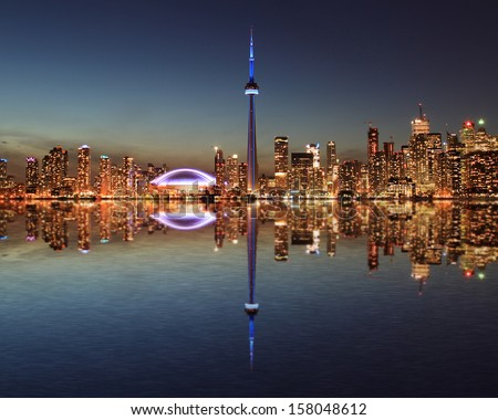 Toronto Skyline at night with a reflection in Lake Ontario.  - stock photo