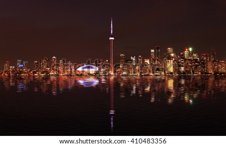 Toronto Skyline at night with a reflection in Lake Ontario. Ontario, Canada - stock photo
