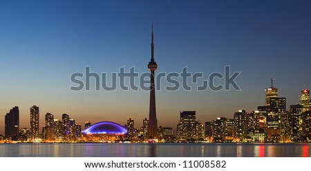 Toronto skyline at sunset as seen from the Centre Island - stock photo