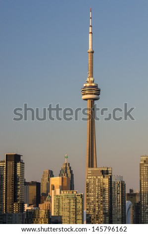 Toronto skyline, CN Tower, skyscrapers , downtown at sunset - stock photo
