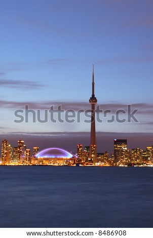 Toronto skyline complete with CN Tower and Rogers Centre (SkyDome) at night. - stock photo