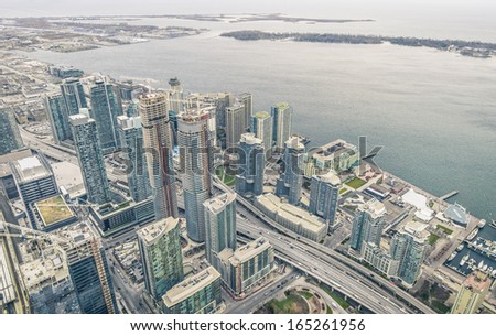 Toronto skyscrapers at waterfront on Ontario Lake - Overview from above - stock photo