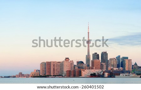 Toronto sunrise with sunlight reflection over lake in the morning