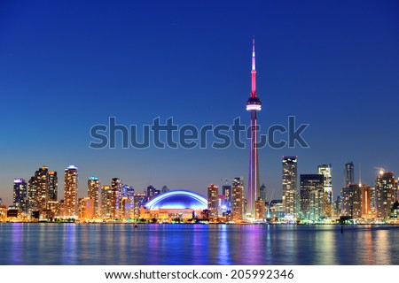 Toronto sunset over lake panorama with urban skyline. - stock photo