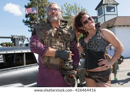 Torrance, USA - May 21, 2016: Post-apocalyptic survival costume couple during 1st Annual Wasteland World Car Show.