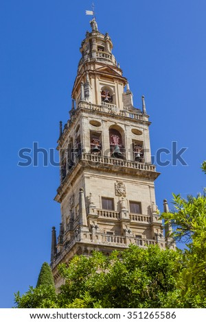 Torre del Alminar Bell Tower Mezquita Cordoba Andalusia Spain.  Created in 785 as a Mosque, was converted to a Cathedral in the 1500.  Bell Tower was constructed on top of minaret.  - stock photo