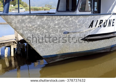 TORRE DEL LAGO, AR/ITALY - 28 JULY 2015: white boat bow with reflections of the water,