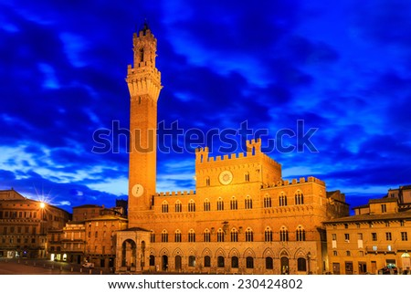 Torre del Mangia and Palazzo Pubblico at twilight, Siena Italy - stock photo