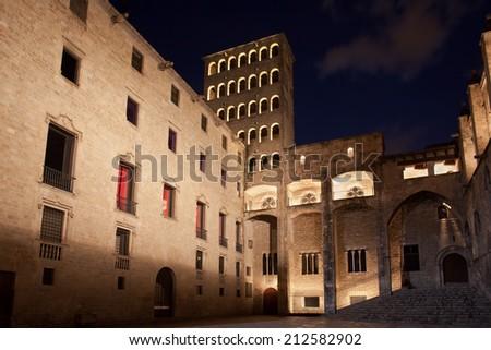 Torre Mirador and Palau del Lloctinent at Placa del Rei at night in Barcelona, Catalonia, Spain. - stock photo
