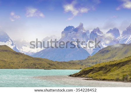 Torres del Paine, Patagonia, Chile with sun flare effects, Patagonia, Chile is famous for tourist. The Patagonia region is one of the most beautiful tourist destination in Chile, south America - stock photo