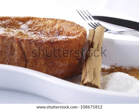 Torrijas � French Toast.  Torrijas are the spanish version of French Toast. Slices of Bread soaked in milk,  egg-coated and fried. Served with sugar and cinnamon. Typical dessert in Easter Season.