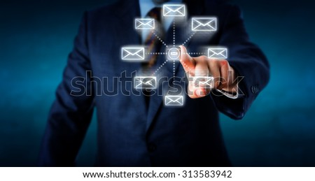 Torso of a businessman sending multiple emails by touching a virtual computer key. Eight email icons are scudding away from the center to leave the outbox. Technology concept. Plenty of copy space.