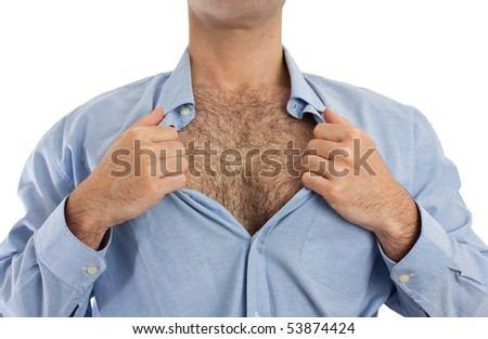 Torso of a man undoing the upper part of his shirt to show his hairy chest. - stock photo