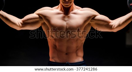 Torso of a young sportsman - stock photo