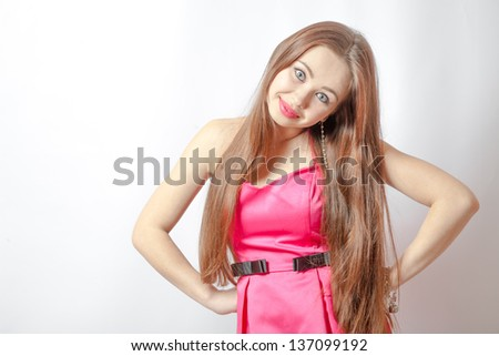 Torso of blond female in pink dress posing - stock photo