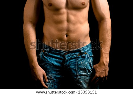 Torso of muscular man with nice abdomen over black - stock photo
