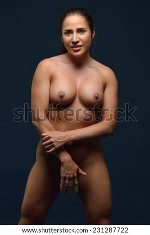 Torso portrait of the Beautiful athletic naked woman shooted in studio. - stock photo
