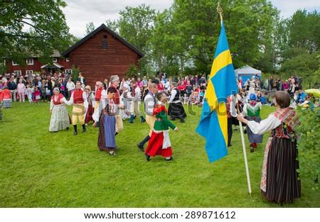 TORSTUNA, SWEDEN - JUNE 19: Unidentified dancing people in  midsummer event. The official name is midsummer event and organization are hembygd Torstuna on June 19, 2015 in Torstuna Sweden - stock photo