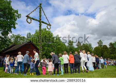 TORSTUNA, SWEDEN- JUNE 19: Unidentified people dancing around maypole in midsummer event. The official name is midsummer event and organization are,hembygd Torstuna on June 19 2015 in Torstuna Sweden - stock photo