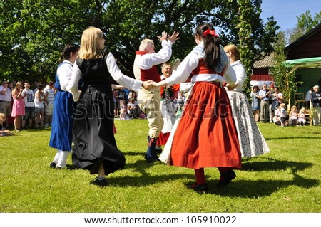 TORSTUNA, SWEDEN - June 19:  Unidentified people in folklore ensemble in traditional folk costume. The official name is midsummer event and org are hembygd Torstuna on June 22, 2012 in Torstuna Sweden