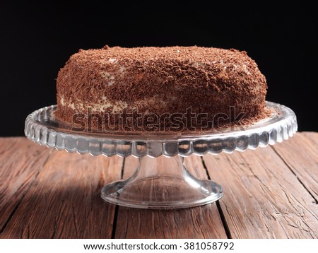 Torte with buttercream (butter cream) filling garnished with grated chocolate
